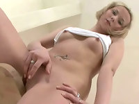 Teen masturbating in the kitchen