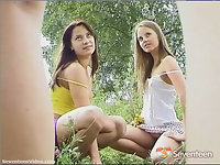 Two teenage girls posing