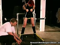 This red headed slut is by far my favorite slave. Her tit torture sessions always turn me on.  Nothing makes me happier than watching my leather clad slave receive a good tit torture. My red headed slave really does love getting her rock hard tits bound and pulled with chains. She complains about the pain when I inflict it, but she always comes back for more... and the days I give her some other kind of torture instead, she misses it. She says, Ive been really bad. I need to have my tits punished.     Then I get stern and tell her, Dont you tell me how to discipline you! You need a spanking! And I blister her butt.