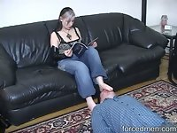 As part of her relaxation, domina reads a magazine and rests her feet on man's face. Having it licked and as well as her toes is also part of it.