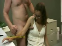 Boss gives cock a handjob in her office