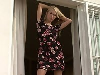 Stunning blonde Judit poses on a large, outdoor balcony wearing a dark, flowery dress and black panties. She slides off her clothes and rubs her tight, shaved pussy while playing with her firm tits. She works her fingers in and out, spread wide with one leg up on the balcony railing, until she has a loud, intense orgasm.