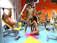 Four naked teenies getting a good sex workout at the gym