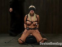 Kait Snow is back for some more punishment.  We plug her big ass, push her clit down on the Sybian and chain her into place.  We chain her neck, her big ole boobs, and her wrists and legs.  She can wiggle, but the more she does the more it pulls on the neck chain for a little breath play. <br> <br> We clamp down hard on her nipples and wrap her head to blindfold her.  She may not be able to see what's coming, but she knows either way, she's fucked.  We zap her, whip her, weight her nipple clamps and turn the Sybian way up.  The Sybian continues to make her come hard while she makes some crazy sounds and tells us what a chain slut she is.