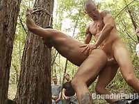 It's a hot summer day and horny men are cruising the wooded trails. Alessio Romero is looking for a blowjob in the bushes, then all of the sudden, Brenn Wyson jumps on him. All the horny dudes get in the action and rip off Alessio's clothes. The helpless stud is made to suck cock and lick ass.  He resists a lot, so Brenn ties him to the trees and beats the hell out of him. Everyone drags him into the campground and takes turns fucking him.