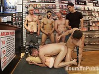 It's the lunch hour rush at the Folsom Gulch adult bookstore. Kyle Braun is dragged off the streets and taken into the store. Tristan Jaxx and Royce subdue the struggling boy as the crowd gathers. The customers rip off Kyle's clothes. They squeeze his nuts until he submits to sucking their cocks. Tristan and Royce take the boy into the video arcade and fuck him in the video booth. They drag him back to the front of the store and flog the hell out him. After much humiliation they all cum all over the boy's face and mouth.